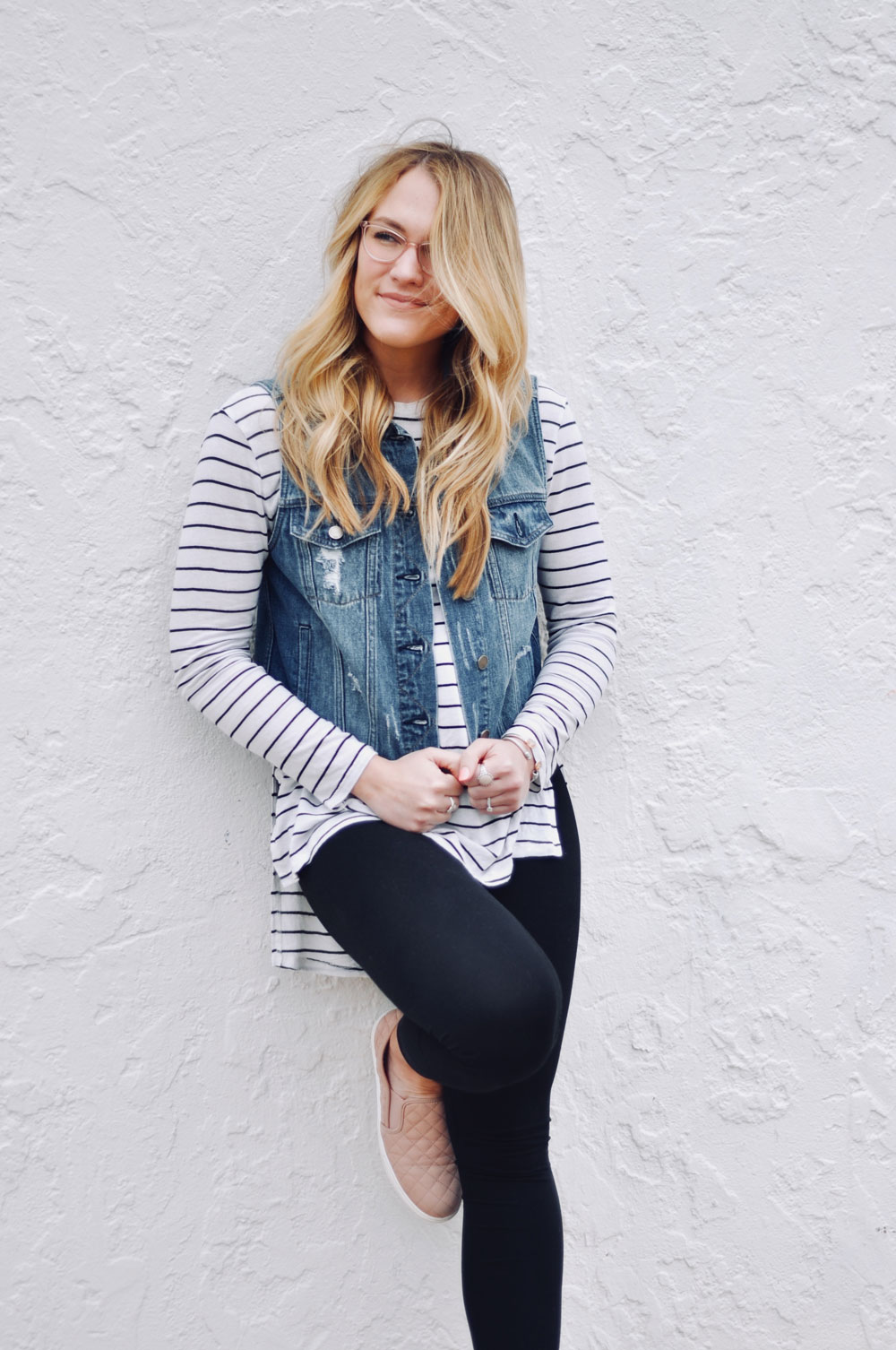 striped tee and jean vest outfit