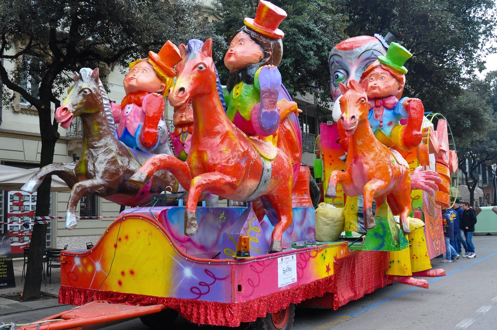 A bright float waiting for the parade for Verona's main Carnival event - Venerdi Gnocolar - to start