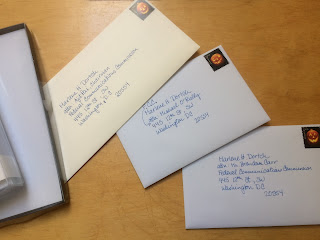 Hand addressed envelopes to commissioners of the FCC