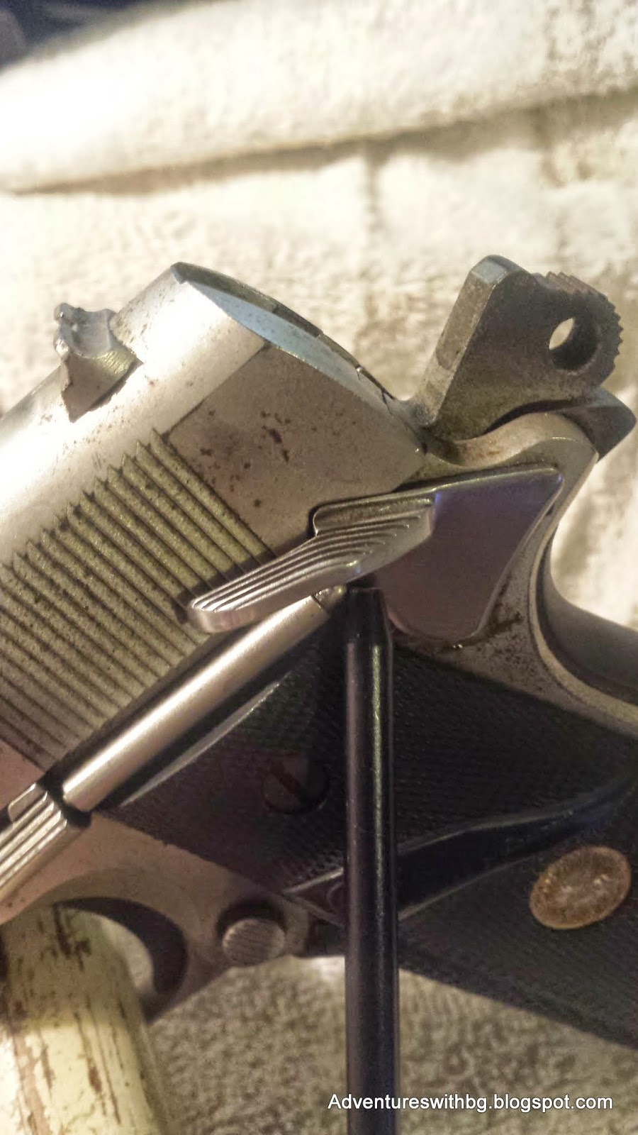 The mechanical safety on a pistol