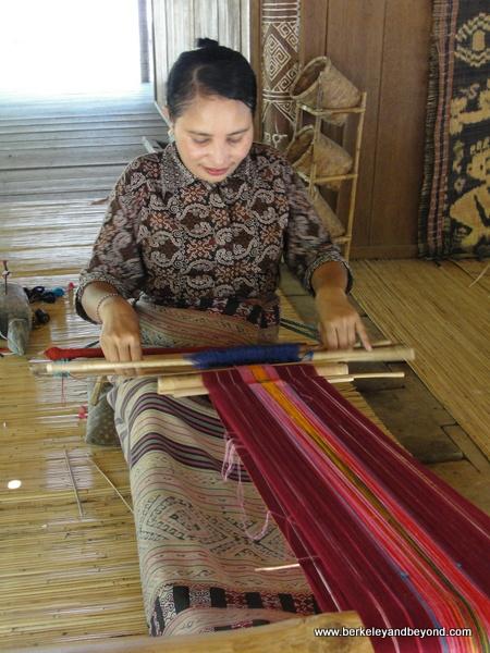 traditional weaving demonstration at Taman Nusa Indonesian cultural park in Bali