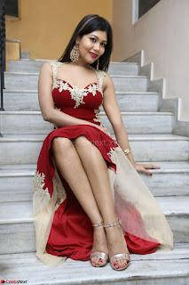 Rachana Smit in Red Deep neck Sleeveless Gown at Idem Deyyam music launch ~ Celebrities Exclusive Galleries