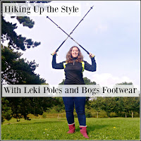 Holding a pair of Leki Hiking Poles and wearing Bogs B-Mocs boots