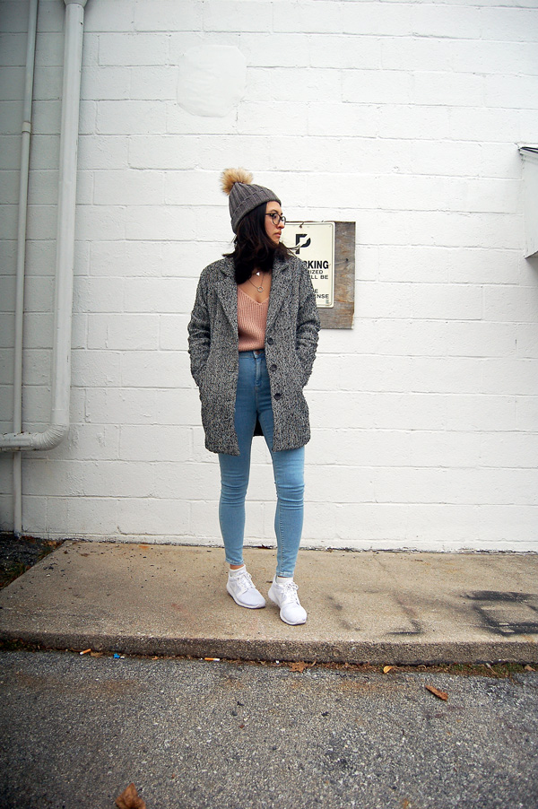 pink sweater blue jeans white sneakers grey coat