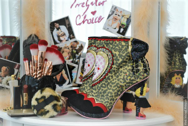 close up of leopard print Miss Piggy Irregular Choice boots on dressing room table