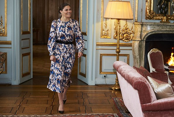 Crown Princess Victoria wore Sandro all-over print silk dress. Princess wore a printed silk dress by Sandro. Valentino small chain shoulder bag