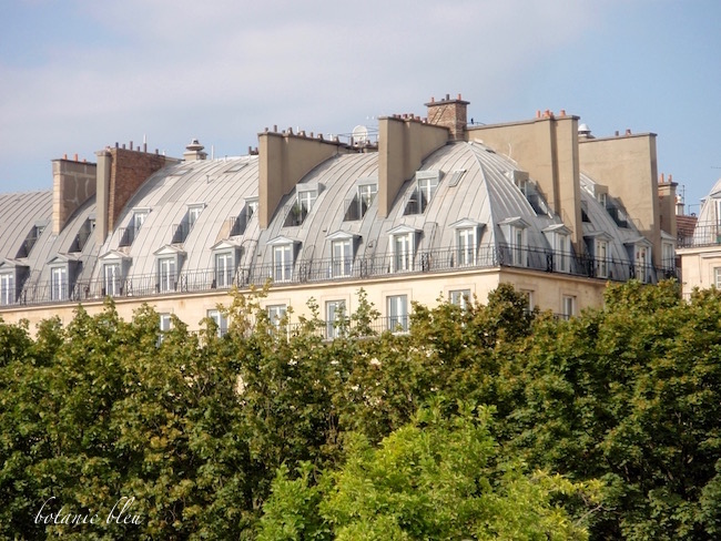 paris-luxury-apartments-overlooking-tuileries-gardens-curved-metal-roofs