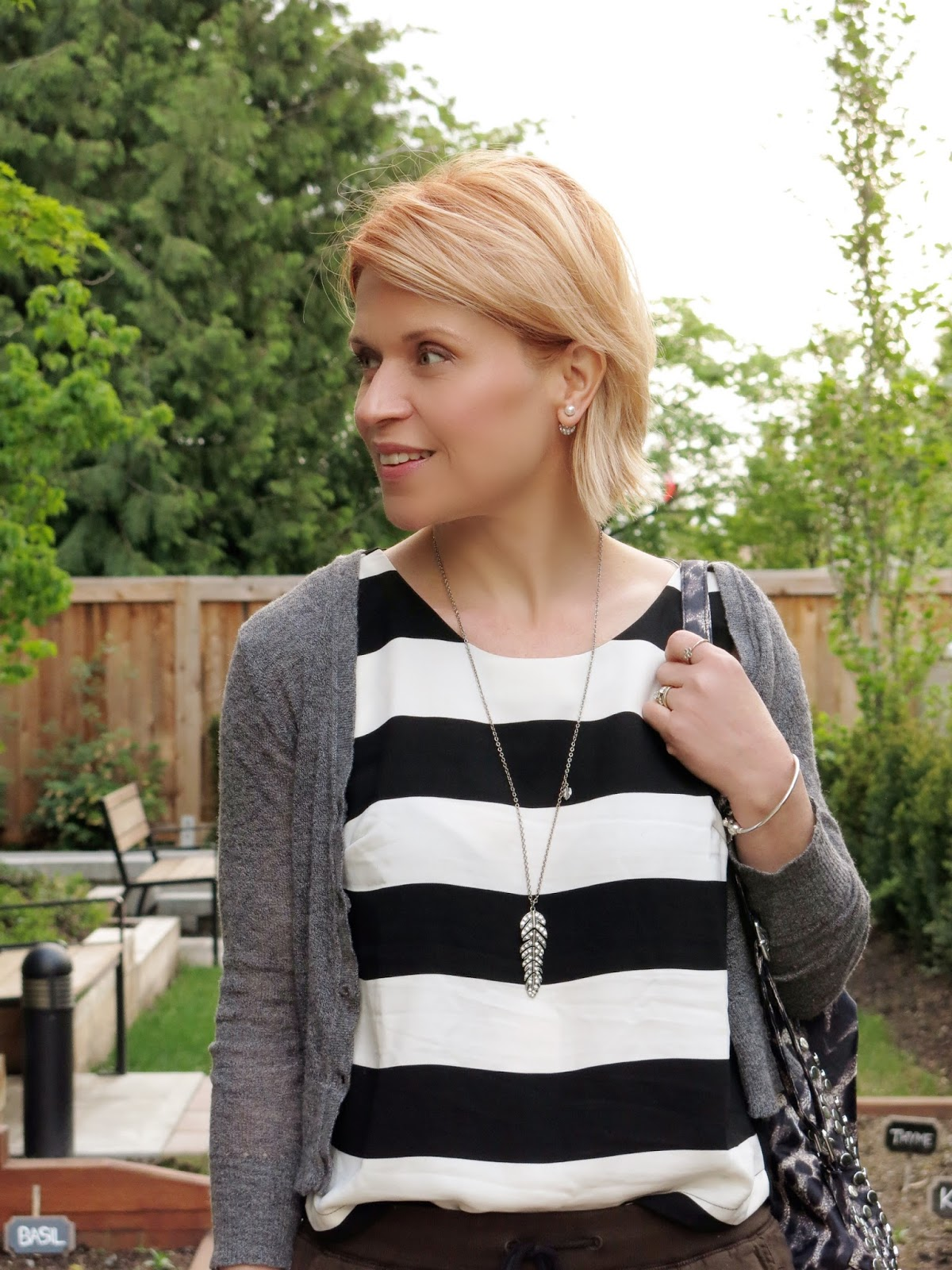striped tank top, shrunken cardigan, leopard-print backpack
