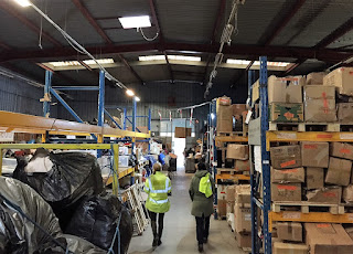 Picture of the inside of the L'Auberge des Migrants warehouse in Calais