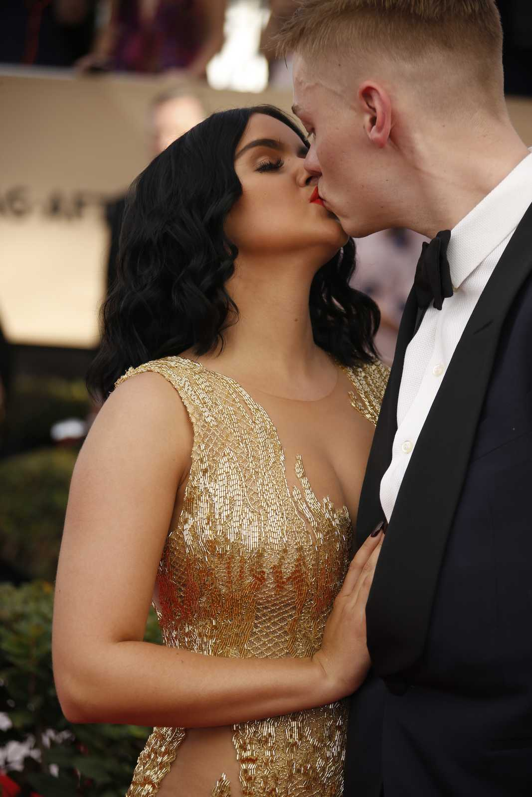 Ariel Winter stuns in gold lace gown as she kisses beau Levi Meaden, 29, at SAG Awards day after her 19th birthday bash
