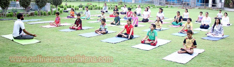 Students performing yoga during Yoga camp at Police DAV Public School