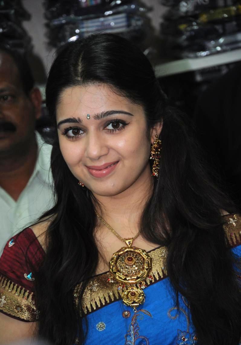 Cute charmi at a showroom launch in saree