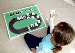 "Tessa and I designed a bulletin board for ""The Race Is On!"" After I set up the race track, Tessa arranged the animals from slowest to fastest around the track."