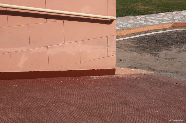 A Minimal Art Photo of the Railing Bar and its Shadow at the Parking Area at Birla Auditorium, Jaipur