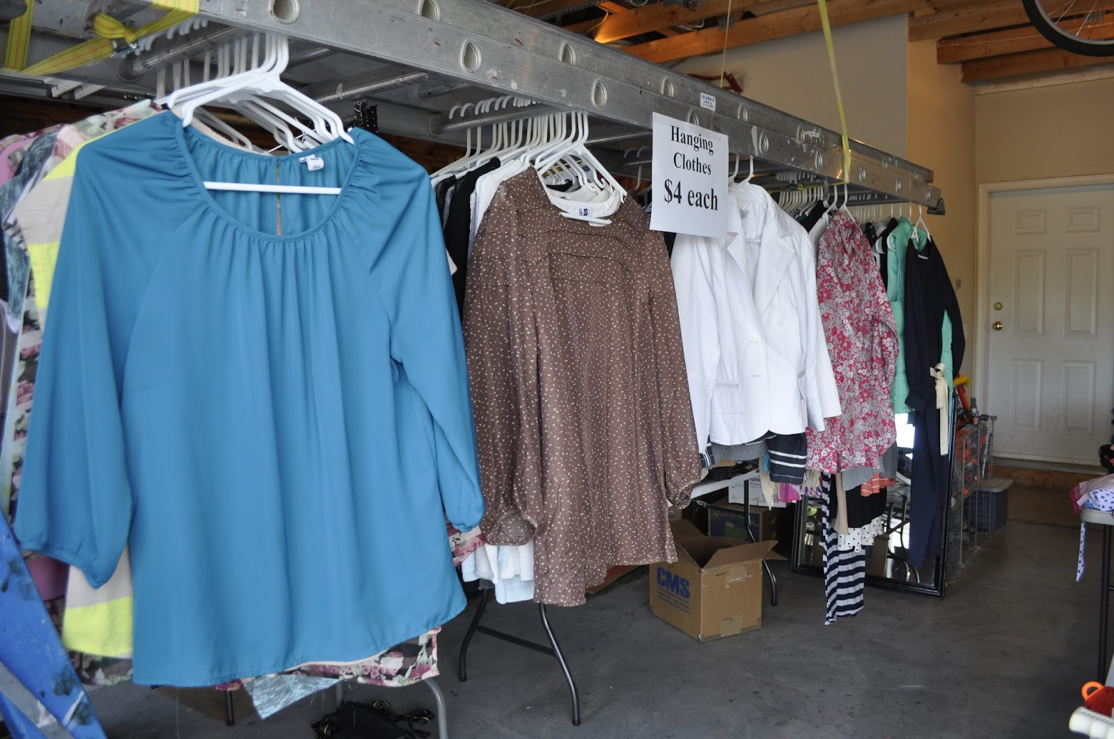 A Place for Every Keeper: Yard Sale How To's #1-5 on homemade round clothes rack for garage sale, ghetto garage sale, yard sale, ideas for garage to hang clothes on sale,