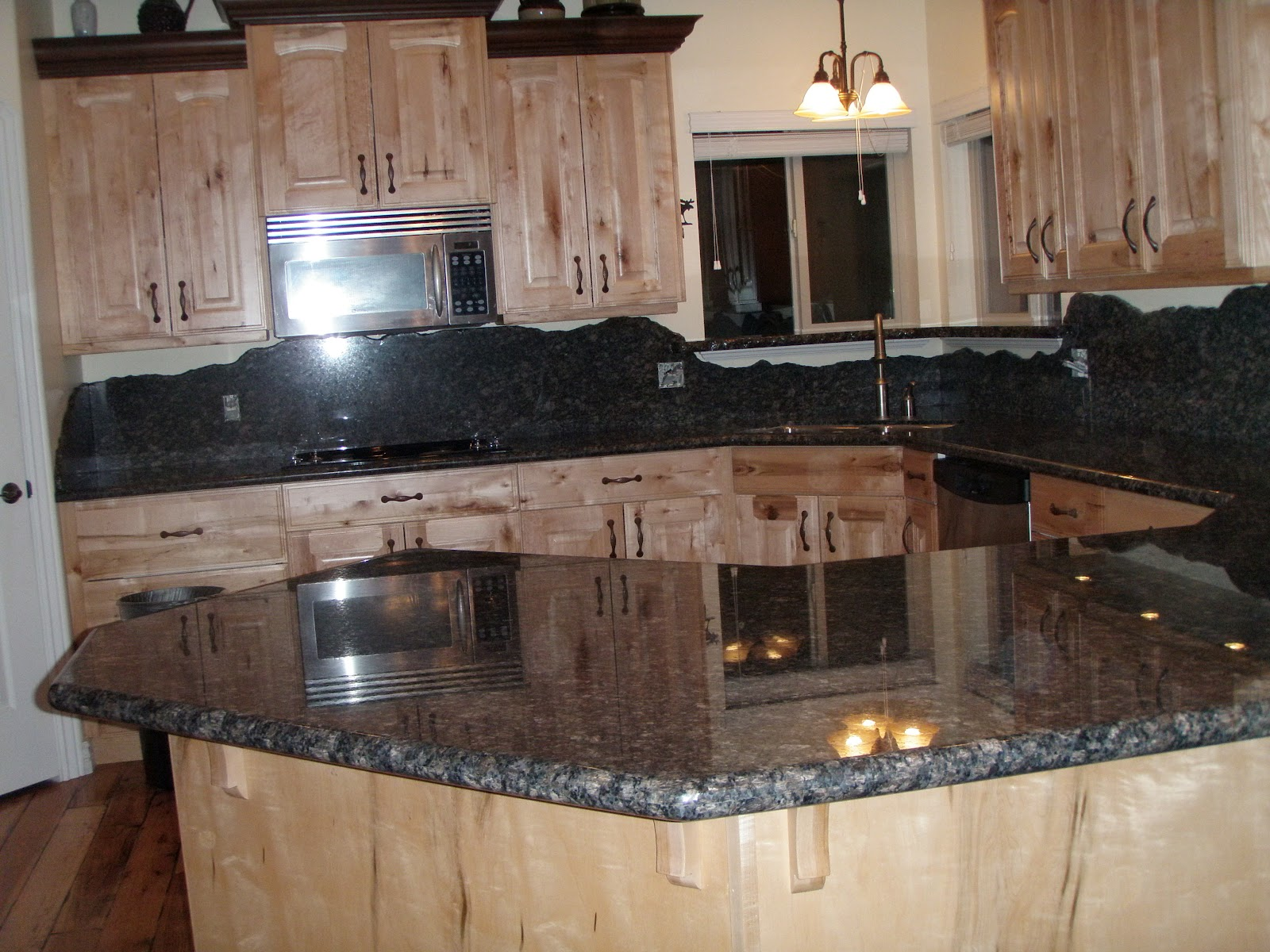 Stone Solutions Granite: Granite or Tile Backsplash on Granite Stove Backsplash  id=13999
