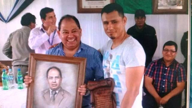 Ministro Romero junto al regente de los internos , el