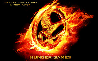 The Hunger Games Flaming Bird with Arrow Logo HD Wallpaper