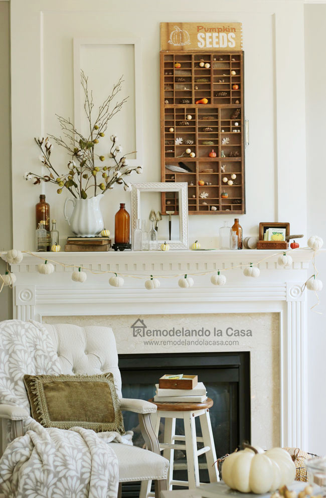 white fireplace decorated for Fall - Home tour with white pitcher with cotton branches