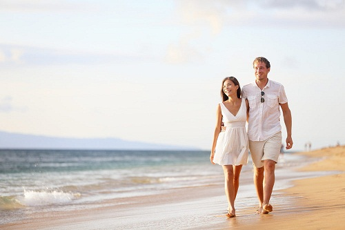 Sweet Love Couple Walking on Beach