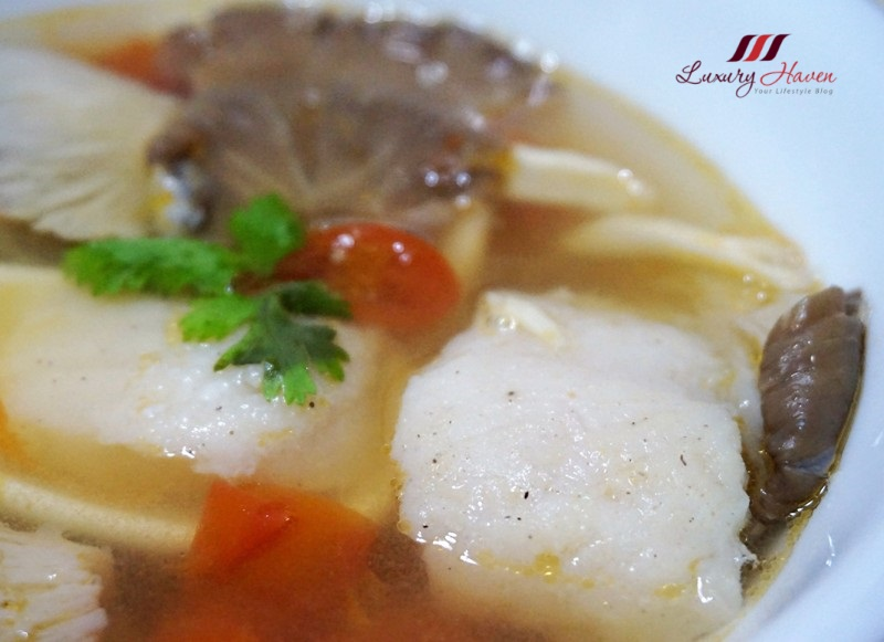 sour thai lemongrass fish soup with oyster mushrooms