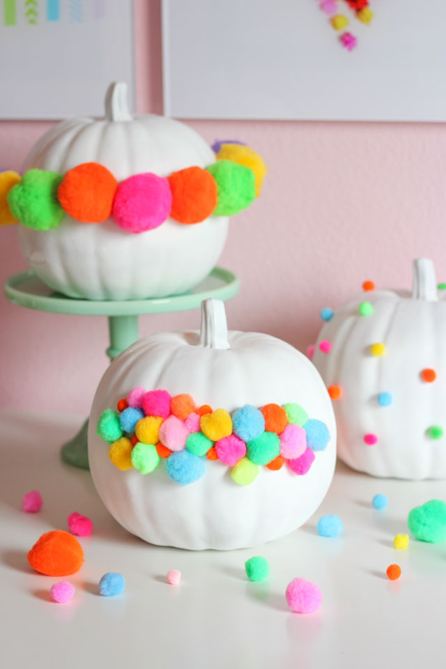 A fun no-carve pumpkin idea - decorate them with pom-poms!