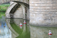 Artist Isaac Cordal's installation Waiting for Climate Change, Nantes, France, 2013 (Credit: Flickr User Objectif Nante) Click to Enlarge.
