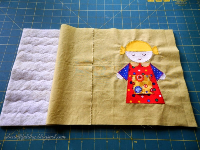 Different quilting designs on the top and backing of the quilt-tutorial-abeeautifulday.blogspot.com