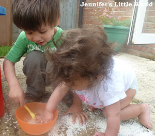 Children making mud pies in the garden