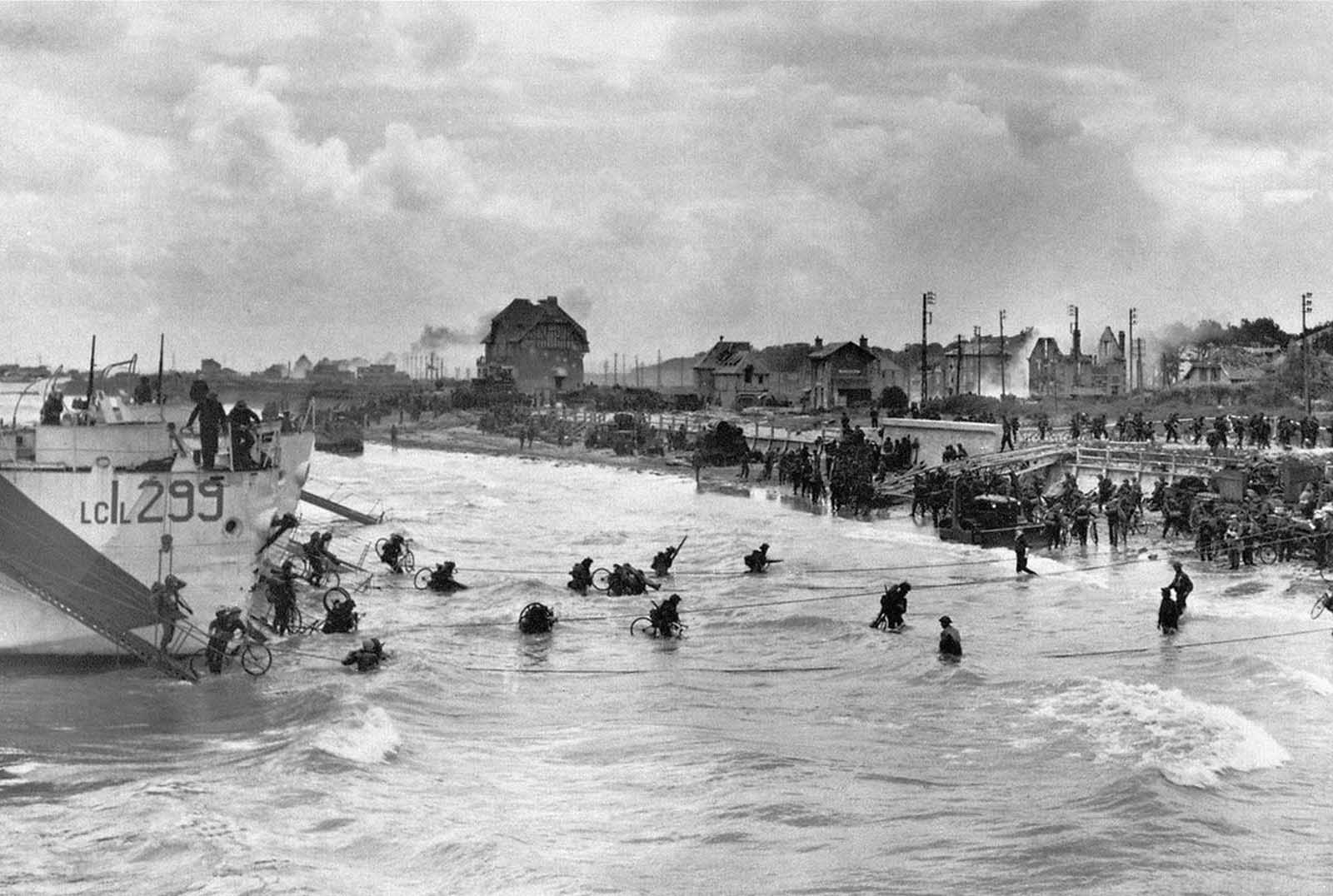 Canadian soldiers from 9th Brigade land with their bicycles at Juno Beach in Bernieres-sur-Mer during D-Day, while Allied forces were storming the Normandy beaches.