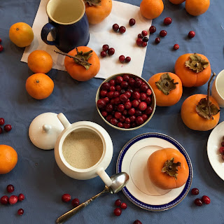 persimmon and cranberry still life setup by sarah sedwick