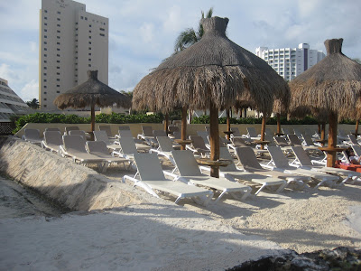 picture of the beach with huts in mexico