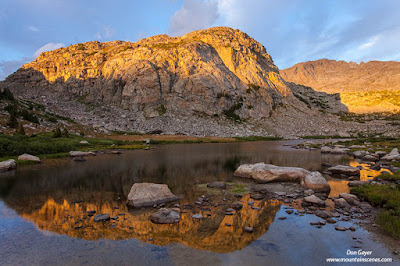A reflection in a high alpine tarn in the Wind River Range of Wyoming, USA.