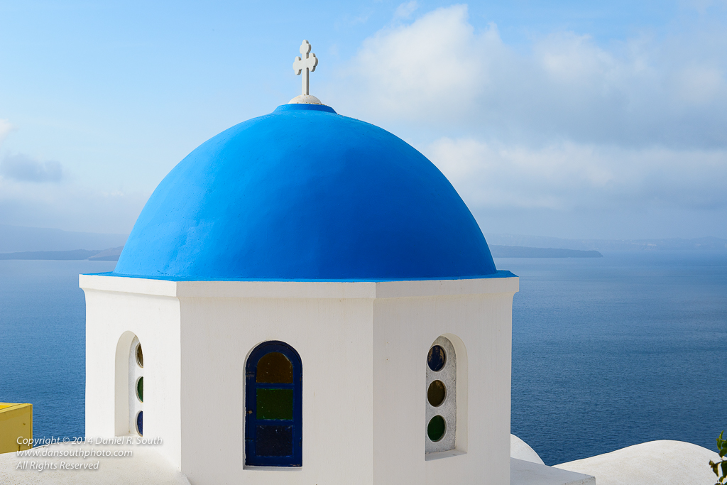 a photo of a chapel with a blue dome santorini