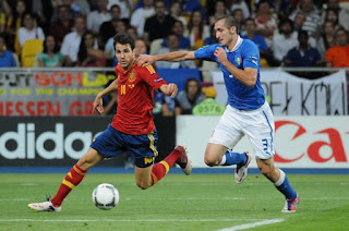 Chiellini in action against Cesc Fabregas of Spain