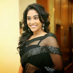 Regina hot wallpapers in black transparent saree
