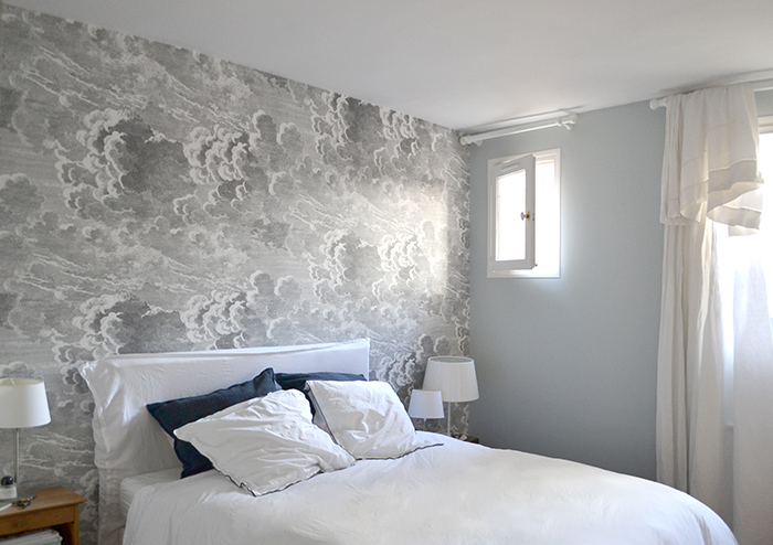 Modern farmhouse style in a white bedroom with Cole and Son wallpaper mural in 1650 Marais Paris home of Lucille Gauthier-Braud. #wallpaper #bedroom #grey #Parisapartment