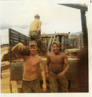 Vietnam War Photo from Walter Bradley c.1970-71: Walter Unloading Ammo