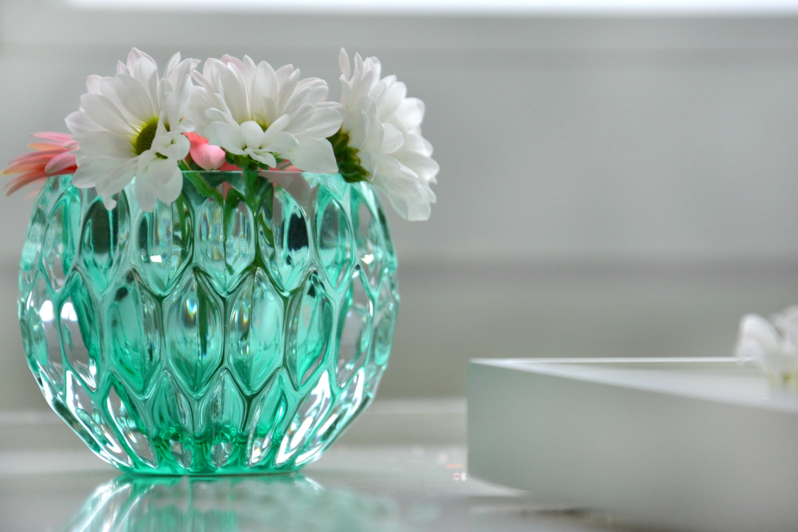 Fresh Flowers in Xenos candle holder