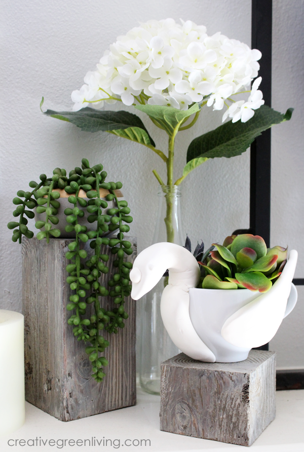 Succulent planters and plants on a fireplace mantle - how to make a succulent planter out of a teacup to look like a swan