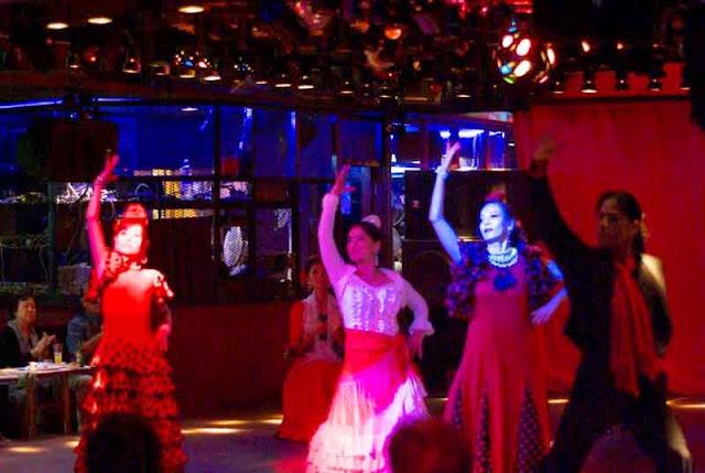 four Flamenco dancers performing at nightclub