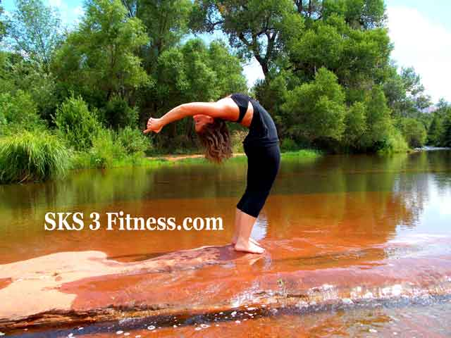 Yoga girl is doing Ardha Chakrasana Steps or Half wheel pose - Standing backbend