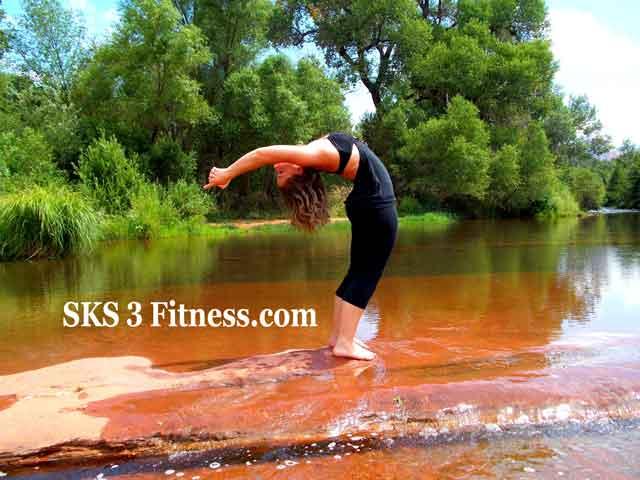 Yoga girl is doing Ardha Chakrasana Steps or Half wheel pose - Standing backbend