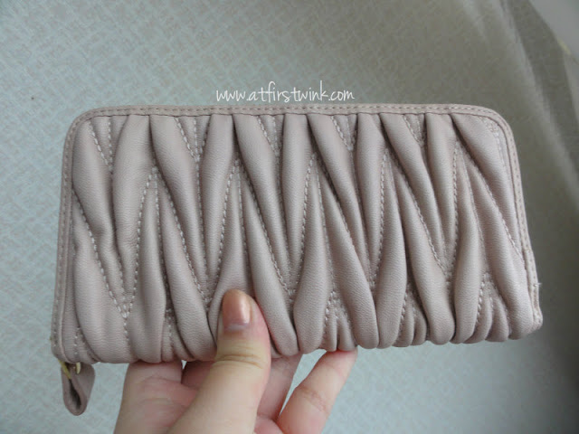 large pale pink rectangular Miu Miu look-a-like wallet
