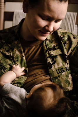 Military mom nursing while in Uniform United States Navy - Morning Owl Fine Art Photography San Diego