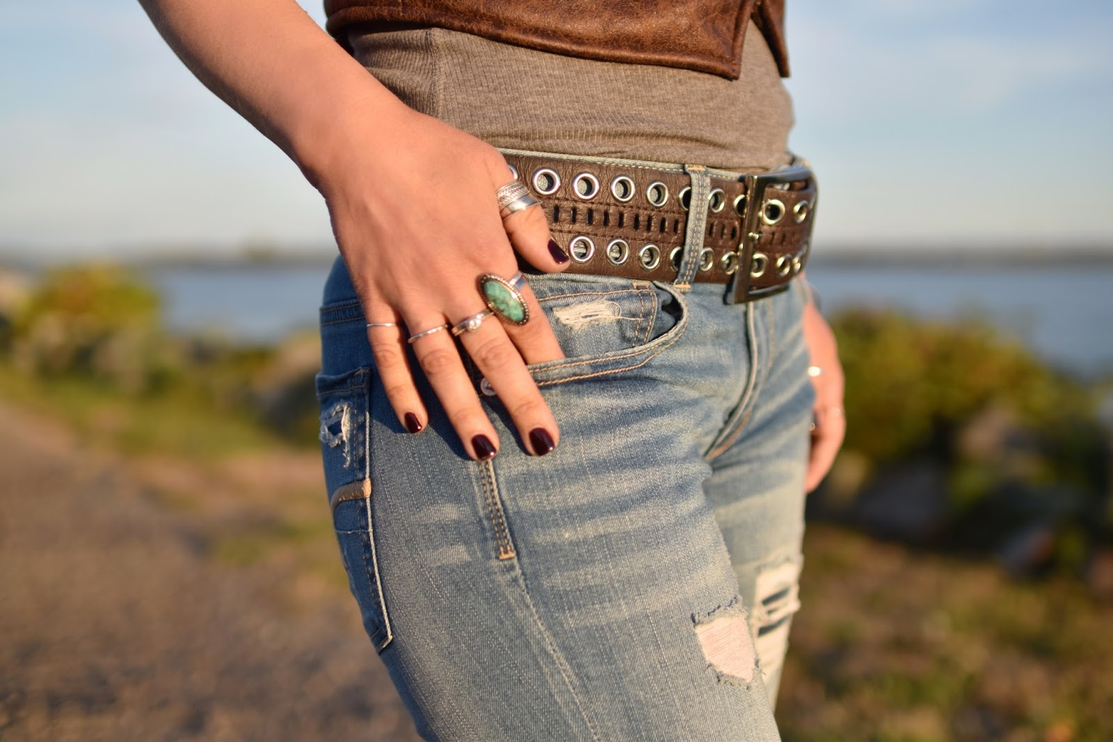 Monika Faulkner outfit inspiration - distressed jeans, grommet-embellished belt, stacked rings