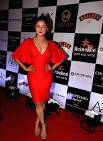 Indian  Girl Rashami Desai Long Cross Legs Tight thighs show in orange top (4).jpg