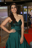 Raashi Khanna in Dark Green Sleeveless Strapless Deep neck Gown at 64th Jio Filmfare Awards South ~  Exclusive 084.JPG