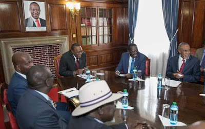 Raila Odinga with President Uhuru Kenyatta at State with Building bridges team. PHOTO | PSCU