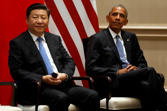 Image Attribute: China's President Xi Jinping (L) and U.S. President Barack Obama participate in a Paris Agreements climate event ahead of the G20 Summit, at West Lake State Guest House in Hangzhou, China September 3, 2016. REUTERS/Jonathan Ernst